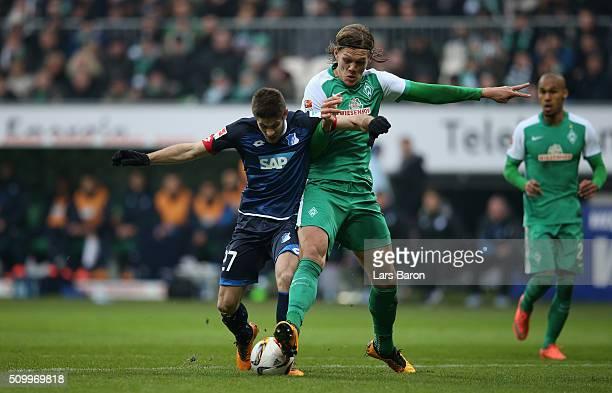 Andrej Kramaric of Hoffenheim is challenged by Jannik Vestergaard of Bremen during the Bundesliga match between Werder Bremen and 1899 Hoffenheim at...