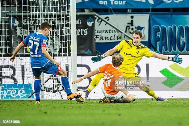 Andrej Kramaric of Hoffenheim scores a disallowed goal afgainst goalkeeper Christian Mathenia of Darmstadt during the Bundesliga match between 1899...