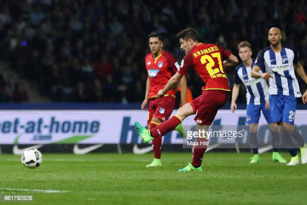 Andrej Kramaric of Hoffenheim scores his team's first goal from the penalty spot during the Bundesliga match between Hertha BSC and TSG 1899...