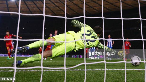 Andrej Kramaric of Hoffenheim scores his team's first goal with a penalty past goalkeeper Rune Jarstein of Berlin during the Bundesliga match between...