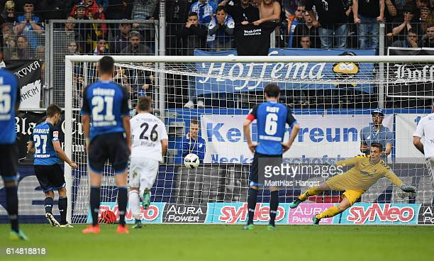 Andrej Kramaric of Hoffenheim scores his team's second goal by penalty past Goalkeeper Alexander Schwolow of Freiburg during the Bundesliga match...
