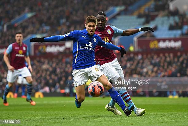Andrej Kramaric of Leicester City and Aly Cissokho of Aston Villa compete for the ball during the FA Cup fifth round match between Aston Villa and...