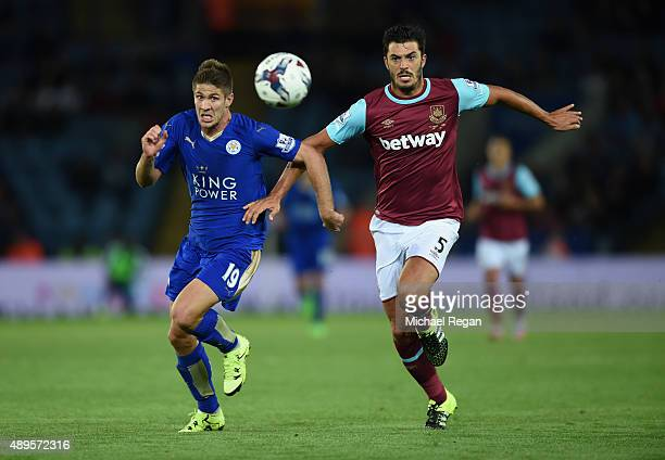 Andrej Kramaric of Leicester in action with James Tomkins of West Ham during the Capital One Cup Third Round match between Leicester City and West...