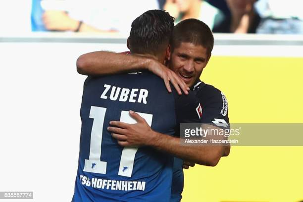 Andrej Kramaric of TSG 1899 Hoffenheim is celebrated by Steven Zuber of TSG 1899 Hoffenheim after he scored to make it 10 during the Bundesliga match...