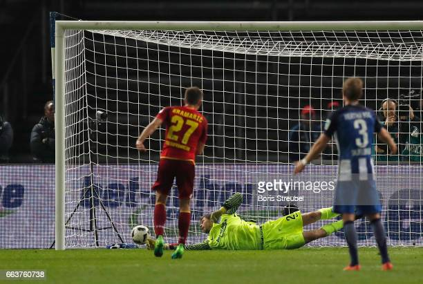 Andrej Kramaric of TSG Hoffenheim scores the penalty against goalkeeper Rune Jarstein of Hertha BSC during the Bundesliga match between Hertha BSC...
