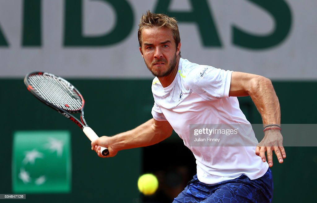 Andrej Martin of Slovakia hits a forehand during the Men's Singles third round match against Milos Raonic of Canada on day six of the 2016 French Open at Roland Garros on May 27, 2016 in Paris, France.