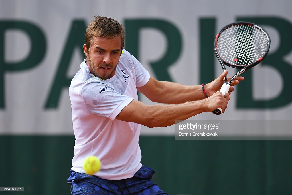 Andrej Martin of Slovakia plays a backhand during the Men's Singles second round match against Lucas Pouille of France on day four of the 2016 French Open at Roland Garros on May 25, 2016 in Paris, France.