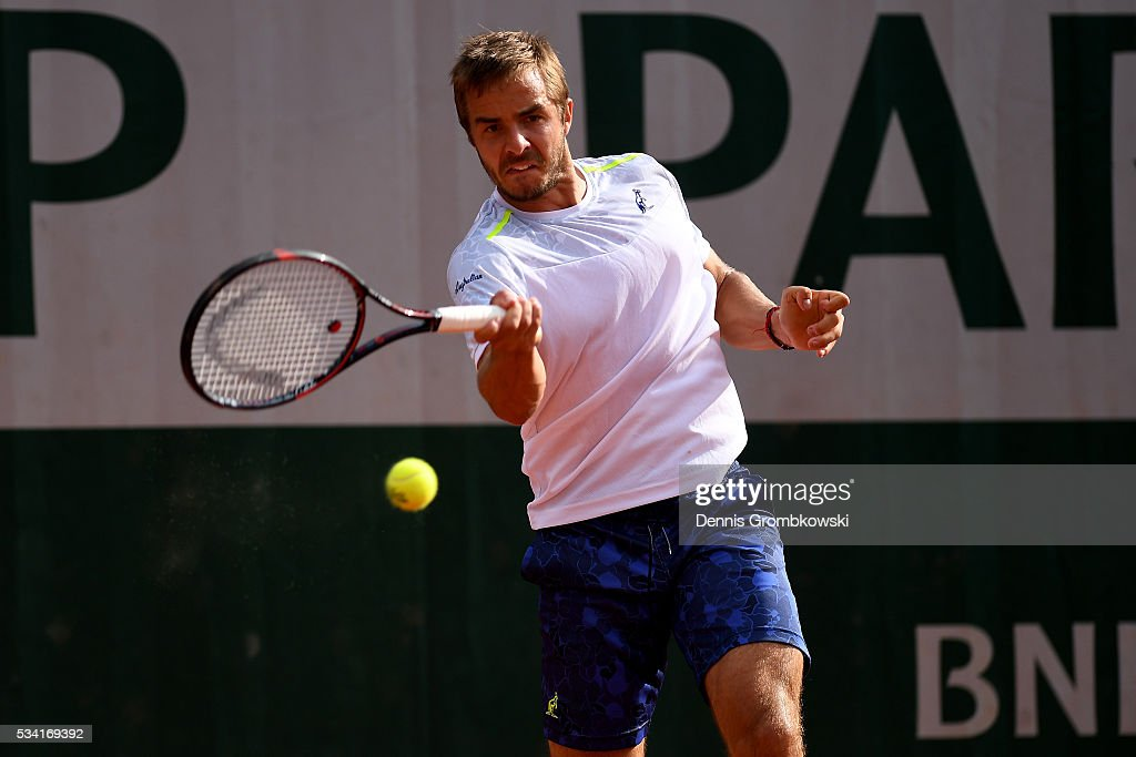 Andrej Martin of Slovakia plays a forehand during the Men's Singles second round match against Lucas Pouille of France on day four of the 2016 French Open at Roland Garros on May 25, 2016 in Paris, France.