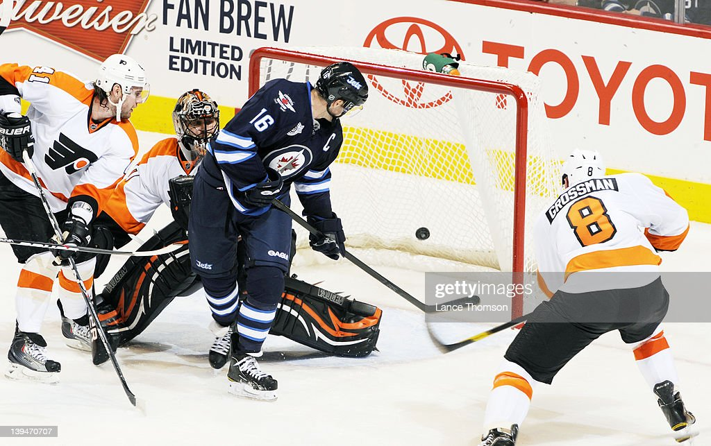 Andrej Meszaros goaltender Ilya Bryzgalov and Nicklas Grossman of the Philadelphia Flyers can only watch as Andrew Ladd of the Winnipeg Jets...