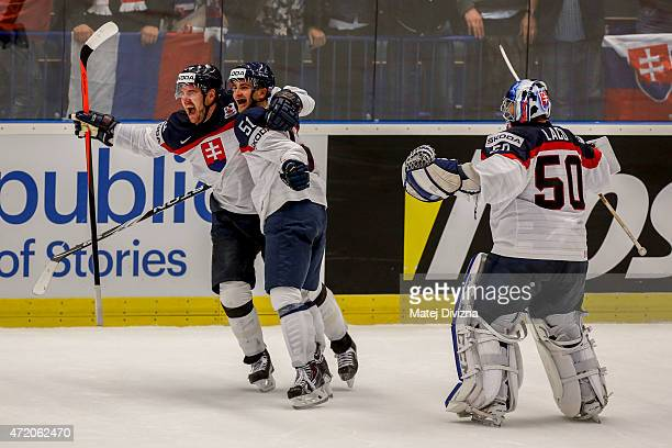 Andrej Meszaros of Slovakia celebrates the golden goal with his teammates during the IIHF World Championship group B match between Belarus and...