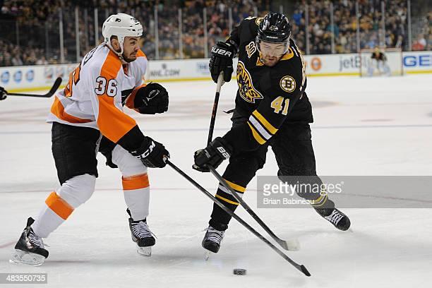 Andrej Meszaros of the Boston Bruins shoots the puck against Zac Rinaldo of the Philadelphia Flyers at the TD Garden on April 5 2014 in Boston...