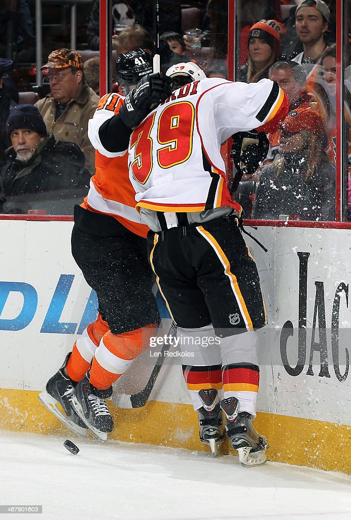 <a gi-track='captionPersonalityLinkClicked' href=/galleries/search?phrase=Andrej+Meszaros&family=editorial&specificpeople=617818 ng-click='$event.stopPropagation()'>Andrej Meszaros</a> #41 of the Philadelphia Flyers battles for the puck along the boards against TJ Galiardi #39 of the Calgary Flames on February 8, 2014 at the Wells Fargo Center in Philadelphia, Pennsylvania.
