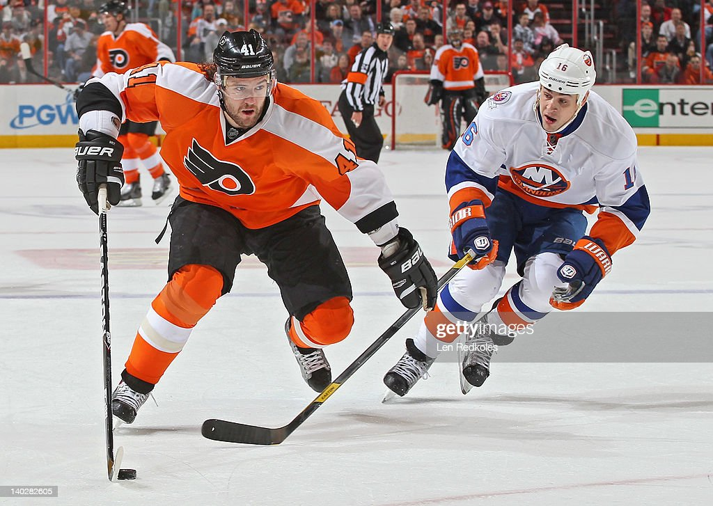 Andrej Meszaros #41 of the Philadelphia Flyers controls the puck while being pursued by Marty Reasoner #16 of the New York Islanders on March 1, 2012 at the Wells Fargo Center in Philadelphia, Pennsylvania.