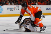 Andrej Meszaros of the Philadelphia Flyers trips Thomas Vanek of the Buffalo Sabres and recieves a two minute penalty in Game Five of the Eastern...