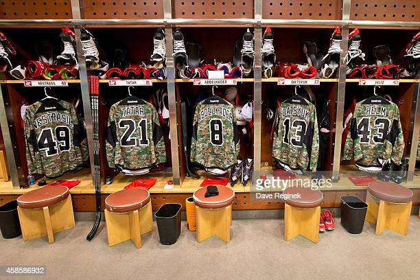 Andrej Nestrasil Tomas Tatar Justin Abdelkader Pavel Datsyuk and Darren Helm of the Detroit Red Wings have 'Camo' jerseys hanging in their lockers...