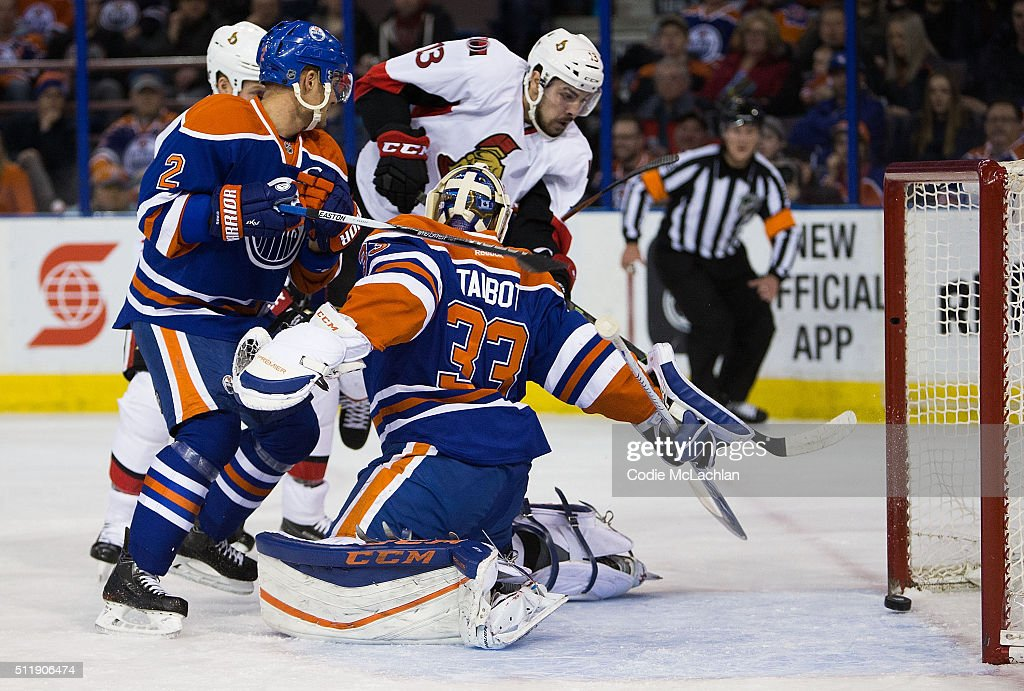Andrej Sekera #2 and goaltender Cam Talbot #33 of the Edmonton Oilers can't stop Nick Paul #13 of the Ottawa Senators from scoring a goal on February 23, 2016 at Rexall Place in Edmonton, Alberta, Canada.