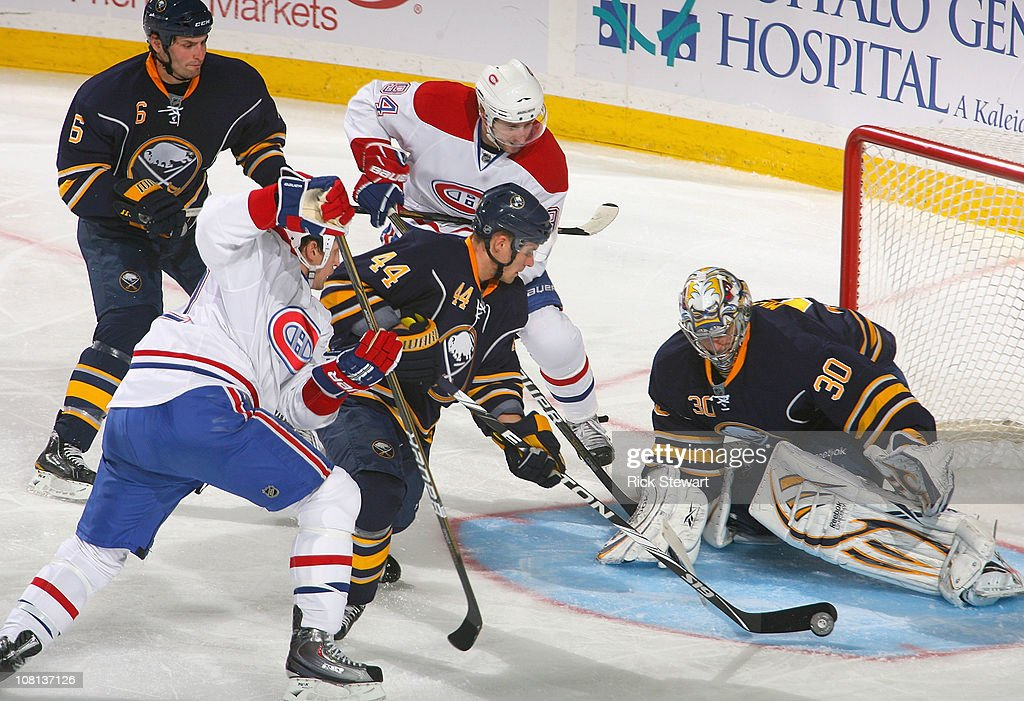 Andrej Sekera #44 and Ryan Miller #30 of the Buffalo Sabres defend against the Montreal Canadiens at HSBC Arena on January 18, 2011 in Buffalo, New York.