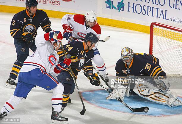 Andrej Sekera and Ryan Miller of the Buffalo Sabres defend against the Montreal Canadiens at HSBC Arena on January 18 2011 in Buffalo New York