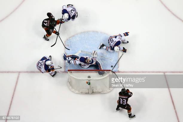 Andrej Sekera Darnell Nurse Matthew Benning and Cam Talbot of the Edmonton Oilers defend as Ryan Kesler and Corey Perry of the Anaheim Ducks skate to...