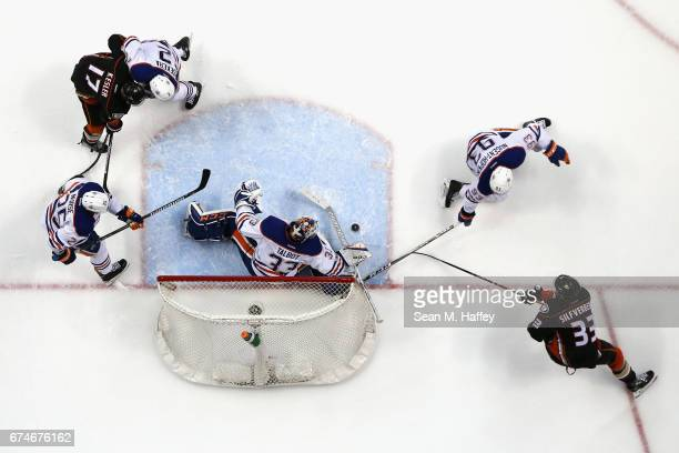 Andrej Sekera Darnell Nurse Matthew Benning and Cam Talbot of the Edmonton Oilers defend as Ryan Kesler and Jakob Silfverberg of the Anaheim Ducks...