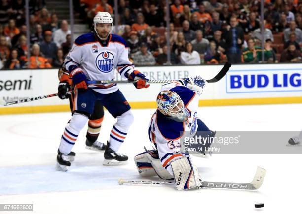 Andrej Sekera defends as Cam Talbot of the Edmonton Oilers blocks a shot on goal during the third period of Game Two of the Western Conference Second...