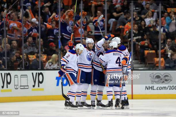 Andrej Sekera is congrautlated by Kris Russell Connor McDavid and Patrick Maroon of the Edmonton Oilers after scoring during the first period of Game...