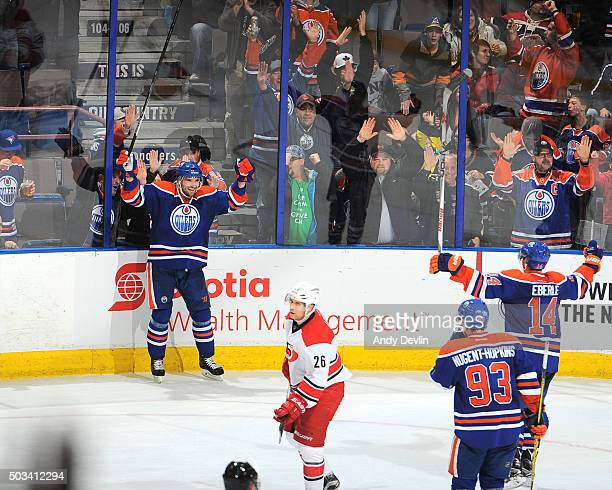 Andrej Sekera Jordan Eberle and Ryan NugentHopkins of the Edmonton Oilers celebrate after winning the game in overtime against the Carolina...