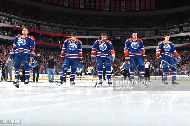 Andrej Sekera Jordan Eberle Kris Russell Milan Lucic and Ryan NugentHopkins of the Edmonton Oilers stand for the singing of the national anthem prior...