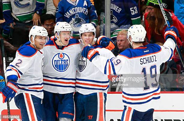 Andrej Sekera Justin Schultz and Taylor Hall congratulate Lauri Korpikoski of the Edmonton Oilers who scored in overtime against the Vancouver...