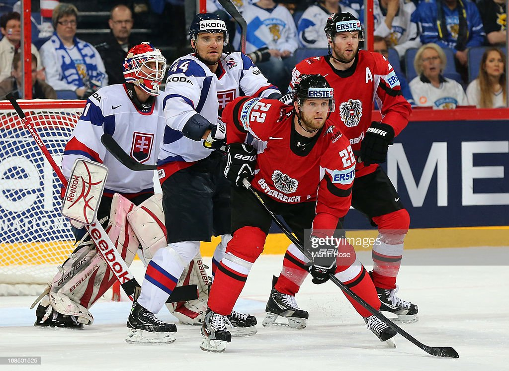 <a gi-track='captionPersonalityLinkClicked' href=/galleries/search?phrase=Andrej+Sekera&family=editorial&specificpeople=722503 ng-click='$event.stopPropagation()'>Andrej Sekera</a> (L) of Slovakia and <a gi-track='captionPersonalityLinkClicked' href=/galleries/search?phrase=Thomas+Pock&family=editorial&specificpeople=220632 ng-click='$event.stopPropagation()'>Thomas Pock</a> (R) of Austria battle for position during the IIHF World Championship group H match between Slovakia and Austria at Hartwall Areena on May 10, 2013 in Helsinki, Finland.