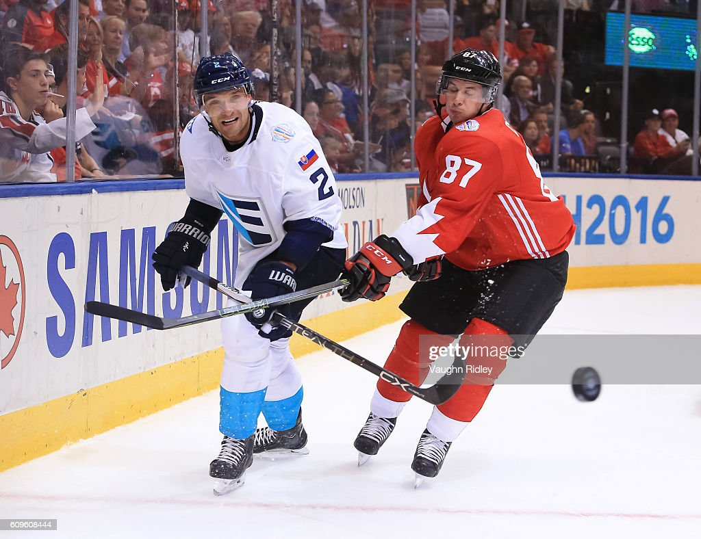 Andrej Sekera #2 of Team Europe and Sidney Crosby #87 of Team Canada chase down a loose puck during the World Cup of Hockey 2016 at Air Canada Centre on September 21, 2016 in Toronto, Ontario, Canada.