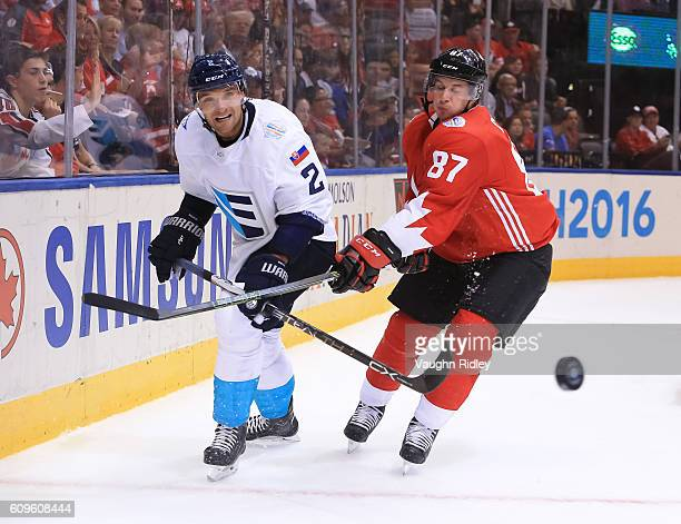 Andrej Sekera of Team Europe and Sidney Crosby of Team Canada chase down a loose puck during the World Cup of Hockey 2016 at Air Canada Centre on...
