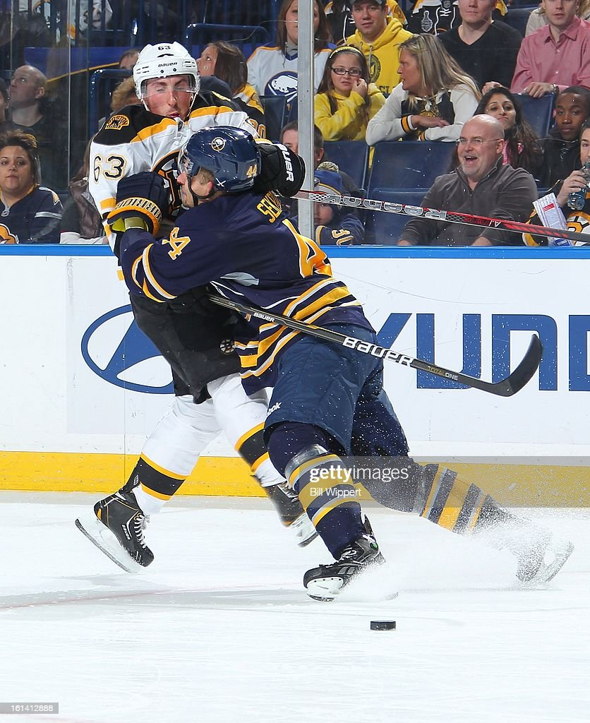 <a gi-track='captionPersonalityLinkClicked' href=/galleries/search?phrase=Andrej+Sekera&family=editorial&specificpeople=722503 ng-click='$event.stopPropagation()'>Andrej Sekera</a> #44 of the Buffalo Sabres checks <a gi-track='captionPersonalityLinkClicked' href=/galleries/search?phrase=Brad+Marchand&family=editorial&specificpeople=2282544 ng-click='$event.stopPropagation()'>Brad Marchand</a> #63 of the Boston Bruins on February 10, 2013 at the First Niagara Center in Buffalo, New York.