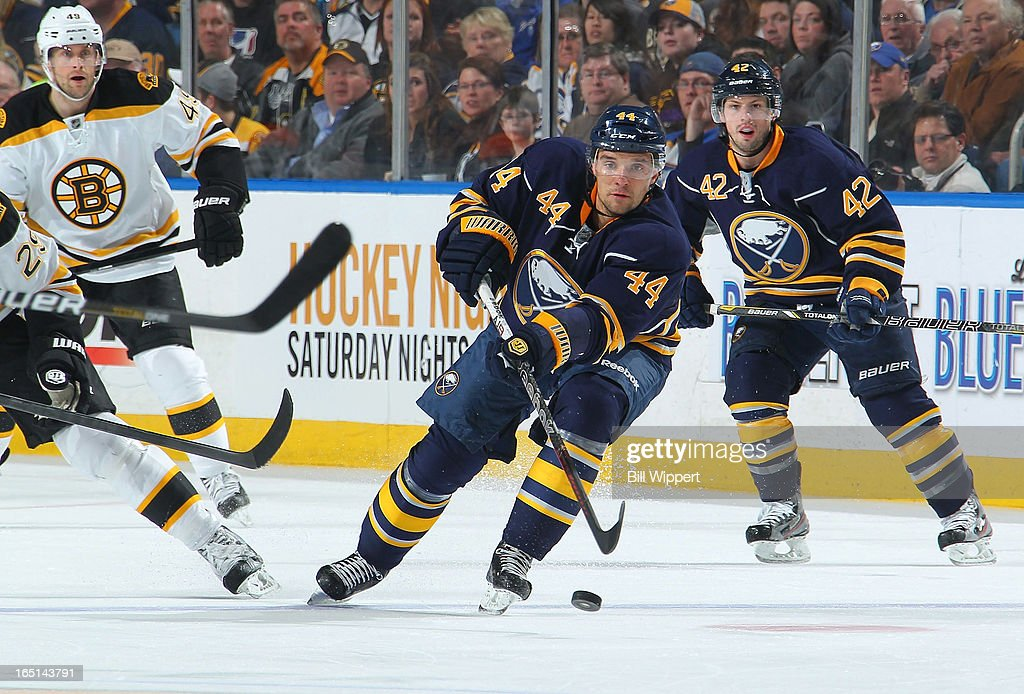 <a gi-track='captionPersonalityLinkClicked' href=/galleries/search?phrase=Andrej+Sekera&family=editorial&specificpeople=722503 ng-click='$event.stopPropagation()'>Andrej Sekera</a> #44 of the Buffalo Sabres passes the puck against the Boston Bruins on March 31, 2013 at the First Niagara Center in Buffalo, New York.