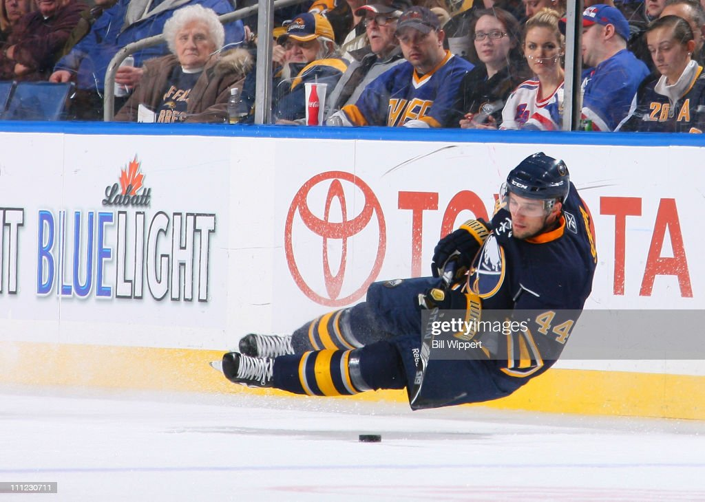 Andrej Sekera #44 of the Buffalo Sabres tries to control the puck after losing his balance against the New York Rangers at HSBC Arena on March 30, 2011 in Buffalo, New York.