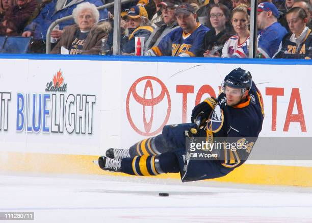 Andrej Sekera of the Buffalo Sabres tries to control the puck after losing his balance against the New York Rangers at HSBC Arena on March 30 2011 in...