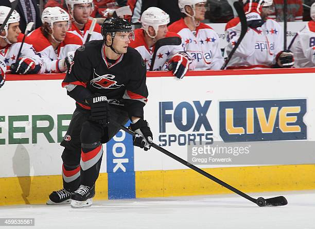 Andrej Sekera of the Carolina Hurricanes controls the puck on the ice during their NHL game against the Washington Capitals at PNC Arena on December...