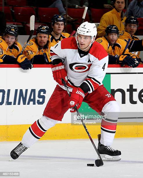 Andrej Sekera of the Carolina Hurricanes controls the puck on the ice during their NHL game against the Nashville Predators at PNC Arena on December...