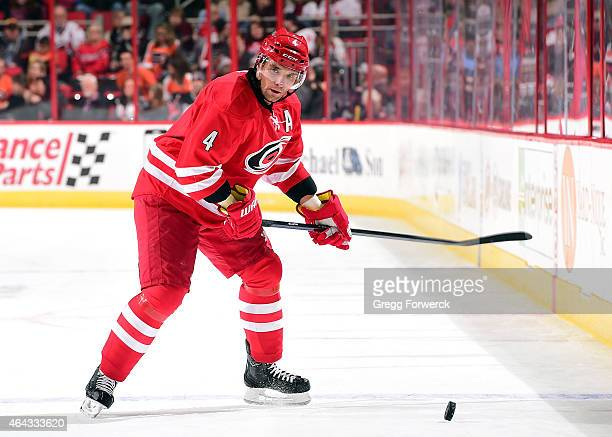 Andrej Sekera of the Carolina Hurricanes looks for passing options before releasing the puck during an NHL game against the Philadelphia Flyers on...