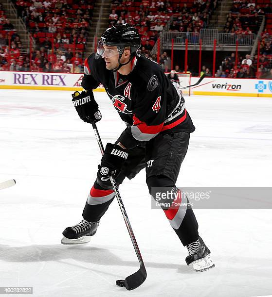 Andrej Sekera of the Carolina Hurricanes looks to snap a wrister on goal during their NHL game against the Detroit Red Wings at PNC Arena on December...