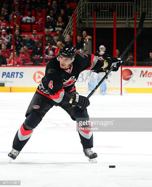 Andrej Sekera of the Carolina Hurricanes prepares to shoot the puck during an NHL game against the New York Rangers on March 7 2014 at PNC Arena in...