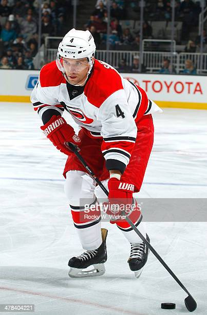 Andrej Sekera of the Carolina Hurricanes skates with the puck against the San Jose Sharks at SAP Center on March 4 2014 in San Jose California