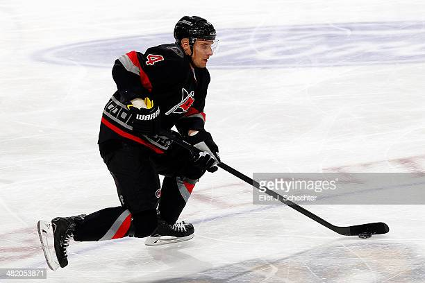 Andrej Sekera of the Carolina Hurricanes skates with the puck against the Florida Panthers at the BBT Center on March 27 2014 in Sunrise Florida
