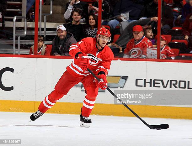 Andrej Sekera of the Carolina Hurricanes skates with the puck during their NHL game againstthe Calgary Flames at PNC Arena on January 13 2014 in...