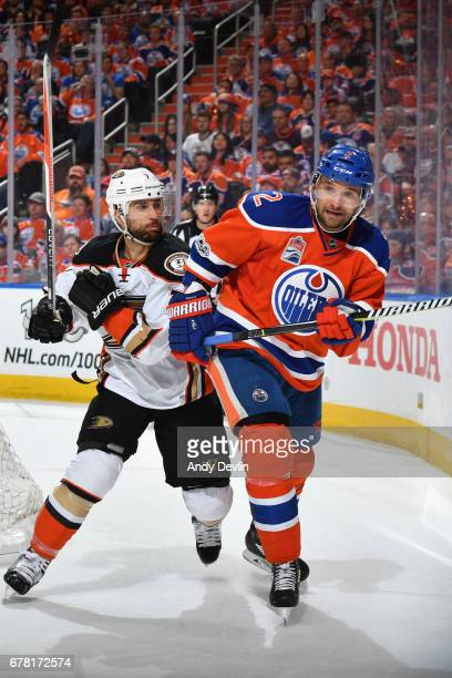 Andrej Sekera of the Edmonton Oilers battles for the puck against Andrew Cogliano of the Anaheim Ducks in Game Four of the Western Conference Second...