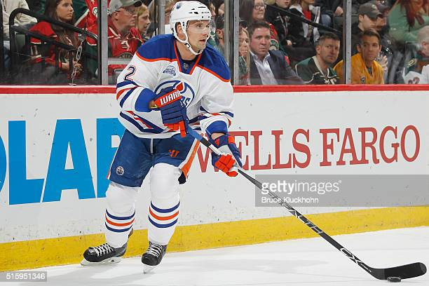 Andrej Sekera of the Edmonton Oilers skates with the puck against the Minnesota Wild during the game on March 10 2016 at the Xcel Energy Center in St...