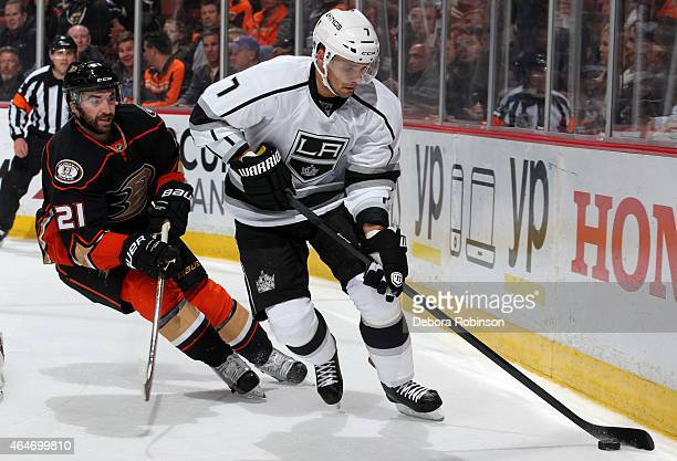 Andrej Sekera of the Los Angeles Kings controls the puck with Kyle Palmieri of the Anaheim Ducks trailing on February 27 2015 at Honda Center in...