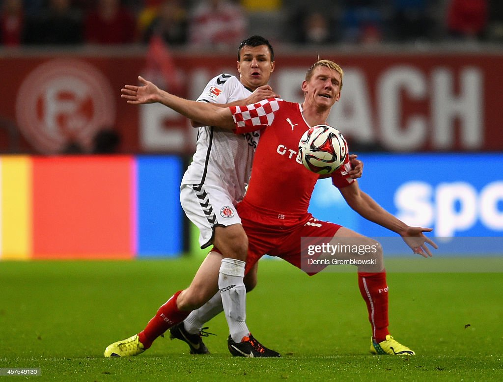 Andrej Startsev of FC St Pauli and Axel Bellinghausen of Fortuna Duesseldorf battle for the ball during the Second Bundesliga match between Fortuna...