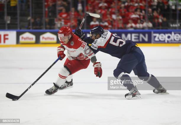 Andrej Stastny of Slovakia challenges Frederik Storm of Denmark for the puck during the 2017 IIHF Ice Hockey World Championship game between Italy...