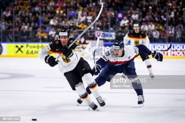 Andrej Stastny of Slovakia challenges Frederik Tiffels of Germany for the puck during the 2017 IIHF Ice Hockey World Championship game between...